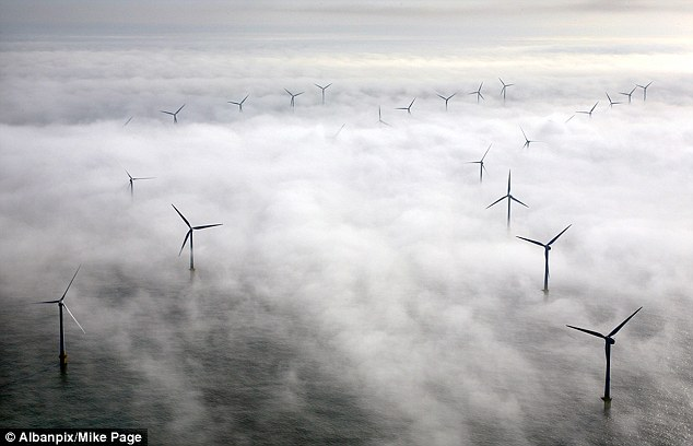 The wind farm at Scroby Sands off East Anglia is shrouded in sea fog caused by its spinning blades